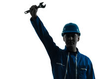Repair man worker saluting silhouette Royalty Free Stock Photography