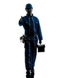 Repair man worker saluting silhouette Royalty Free Stock Image