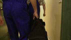 Repair men walking down corridor in apartment building, housing and utility. Stock footage stock footage