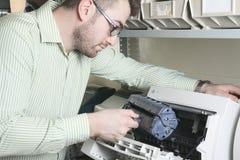 Repair men at work Stock Photo