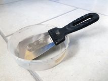Repair - metal trowel and rubber trowel for grouting stock images
