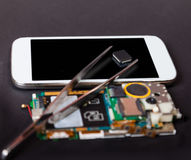 Repair of mobile devices. Electronics background Royalty Free Stock Images