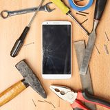 Repair mobile phone composition Royalty Free Stock Photos