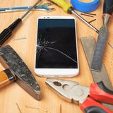 Repair mobile phone composition Royalty Free Stock Images