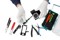 Repair of the modern  photo camera at professional service cente Royalty Free Stock Images