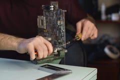 Repair motherboard. Microelectronics stock photos
