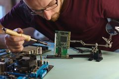Repair motherboard. Microelectronics royalty free stock photography