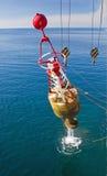 Repair navigational buoys at sea. Lifting navigational buoy for repair Royalty Free Stock Photos