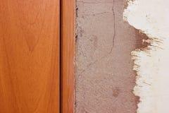 Repair near the door. Abetoned wall near the door to the room Stock Images
