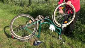 Repair old bicycle on yard grass stock footage