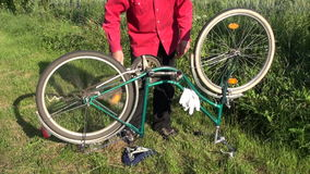 Repair old bicycle on yard grass stock video