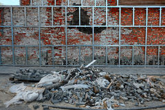 Repair of old brick wall. Mounting new surface on aluminium rails. Stock Images