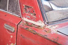 Repair of the old car: primer, putty Stock Photo