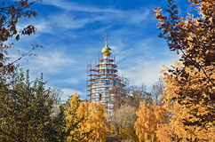 Repair the old church in the autumn forest. Moscow Royalty Free Stock Photography