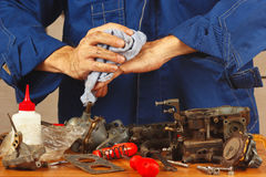 Repair of old parts of automotive engine in workshop Stock Images