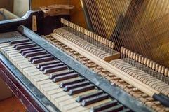 Repair of old piano. Repair old piano, musical instrument, repair music, white keys and strings Stock Image