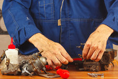 Repair of parts of automobile engine in the workshop Stock Image