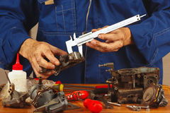 Repair of parts of automotive engine in workshop Stock Photography