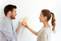 Happy couple with color samples at new home Royalty Free Stock Image