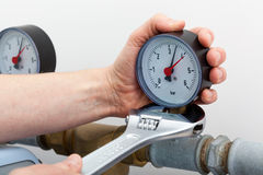 Repair of a pressure gauge. With wrench royalty free stock photos