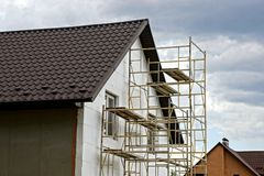 Repair of a private house with a brown tiled roof Royalty Free Stock Photos