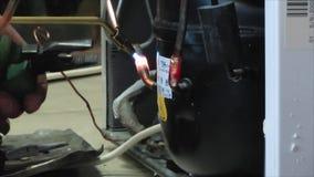 Repair the refrigerator stock video footage