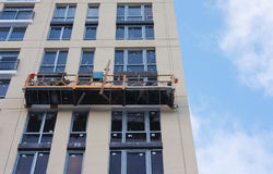 Repair and restoration of a facade of a high building. Royalty Free Stock Images