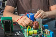 Repair and restoration of a large power supply, diagnostics and troubleshooting.  royalty free stock image