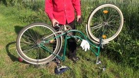 Repair retro bicycle on garden grass stock video