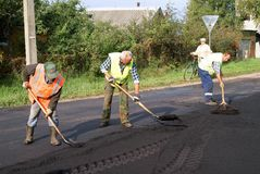 The repair of the road. Road workers were repairing the road Royalty Free Stock Photography