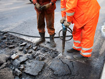 Repair of roads. Workers repairing a road in a big city Stock Photo