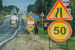 Repair of roads in Central Russia. In Russia in recent years has started repair of the road pavement of the Federal and regional highways and freeways. Workers stock photos