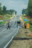 Repair of roads in Central Russia. In Russia in recent years has started repair of the road pavement of the Federal and regional highways and freeways. Workers royalty free stock image