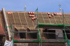 Repair a roof Stock Images