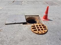 Repair rust drain on street Royalty Free Stock Images