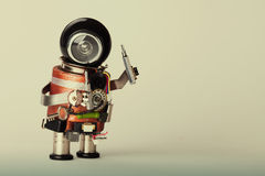 Repair service concept. Retro style robot handyman with screwdriver. Fun toy character, black helmet head. gradient background, ma Royalty Free Stock Photos