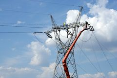 Repair service on power pylon. Repair service on power electricity pylon Stock Photos