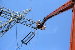 Repair service on power pylon Stock Photography