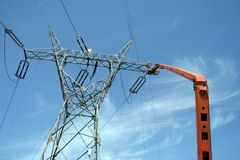 Repair service on power pylon Royalty Free Stock Photo