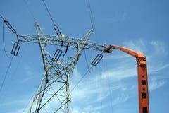 Repair service on power pylon. Repair service on power electricity pylon Royalty Free Stock Photo