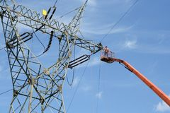 Repair service on power pylon Royalty Free Stock Image