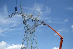 Repair service on power pylon. Repair service on power electricity pylon Royalty Free Stock Photography