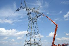 Repair service on power pylon. Repair service on power electricity pylon Royalty Free Stock Image