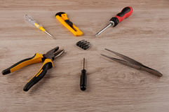 Repair set of different tools lay on wooden table Royalty Free Stock Photos