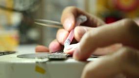 Repair shop carries out repair of smartphones stock footage