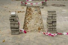 Repair of sidewalk tiles Royalty Free Stock Images