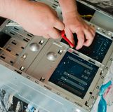 Repair of the system unit of the stationary personal computer stock image
