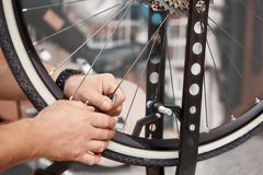Repair technician bicycles was repaired gear bike shop. Royalty Free Stock Images