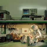 Repair time. Robotic lab. Robot and instruments Royalty Free Stock Image