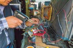 Repair with tin soldering of cathode ray tube monitors. Repair with tin soldering cathode ray tube monitors Ecuador stock photo
